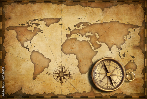 aged-brass-antique-nautical-pocket-compass-with-old-map
