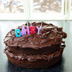 Chocolate birthday cake with Dairy candles