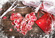 vintage heart from flowers with a gift on wooden table