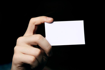 Man holding business card. Close up shot