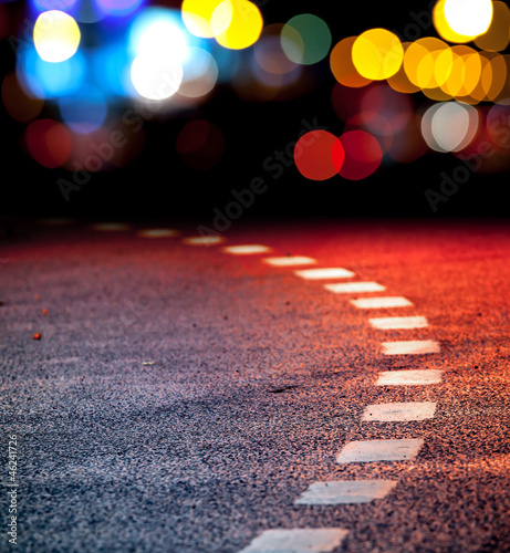 Turning asphalt road with marking lines and lights