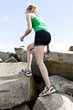 Female runner on rocks