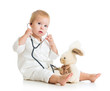 Adorable child with clothes of doctor examining hare toy over wh