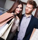 Happy couple goes shopping