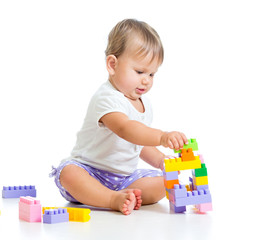 little cheerful child with construction set over white backgroun