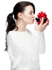 Young woman kissing a gift - isolated