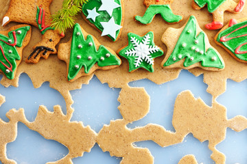 Christmas gingerbread cookies over dough