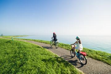 Kids riding bikes on summer day