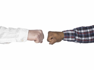 two hands making fist bump