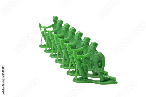green toy soldiers kneeling on the ground