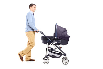 Full length portrait of a father pushing a baby stroller