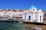 View of Mykonos harbor with blue dome church, Greece