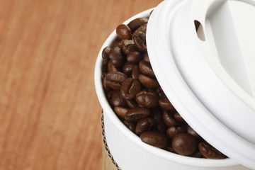 Coffee Beans in Disposable Cup