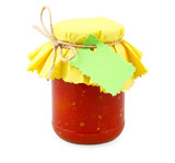 jar with tomatoes with green label and yellow paper on white