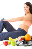 Diet and sport - young woman is doing sit-ups