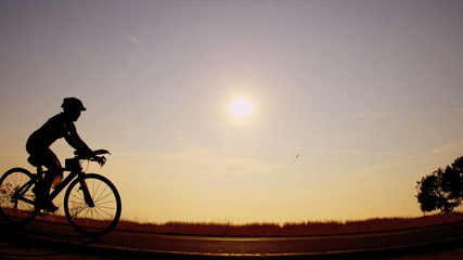 Sunrise cycling people on track