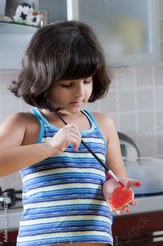 girl painting the martorana fruit