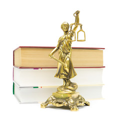 Justice statue and books isolated on white background