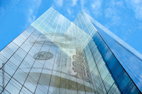 Office building with hundred dollar bill