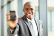 african american businessman holding a smart phone
