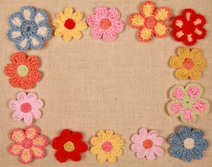 frame of knitted flowers