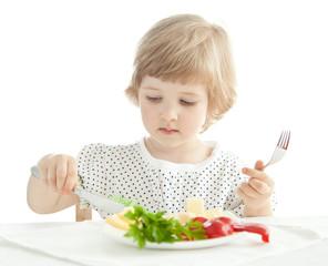 Little girl eating her dinner