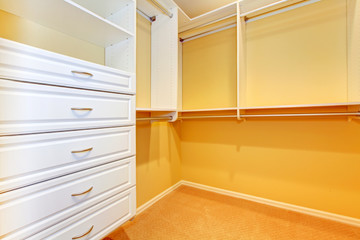 Large walk in Closet with shelve system.