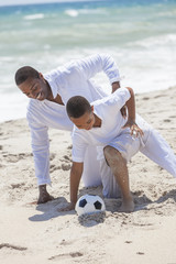 African American Father Son Playing Soccer Beach