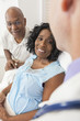 Senior African American Woman Patient in Hospital Bed