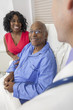 Senior African American Man Patient in Hospital Bed