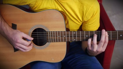 Bard musicians hands  playing song on guitar