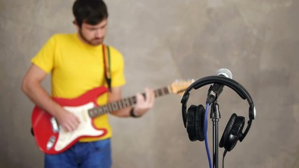 Musician playing with headphones and microphone in front