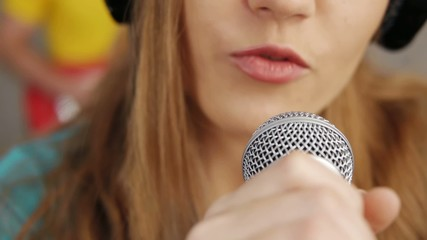 female hand touching microphone  and singing song
