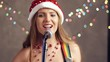 Beautiful woman in Christmas hat playing on guitar