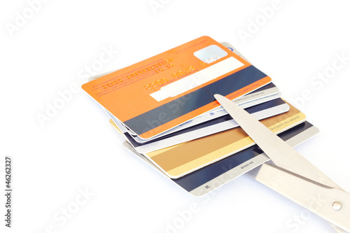 credit cards and scissors on white background