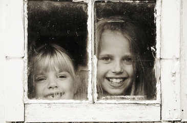 kids in grungy window