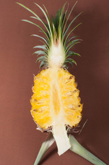 Fresh Pineapple on brown background