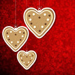 Christmas background with gingerbread hearts.