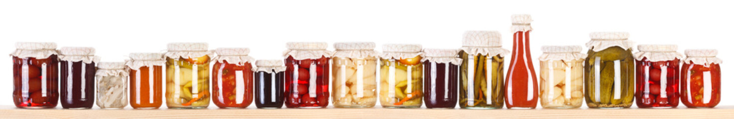 Long line of various preserves on a shelf