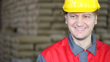 Happy and Smiling Worker in Warehouse