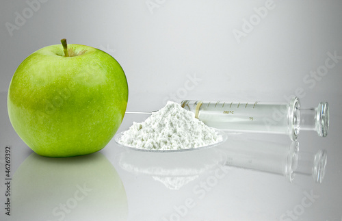 green Apple with medicine and injection