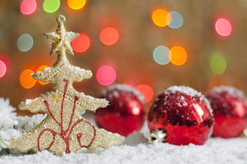Christmas tree and baubles against blurred colorful background