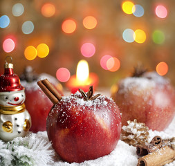 Christmas food apples on snow closeup and blurred background