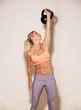 Strong Woman Lifting a Kettlebell