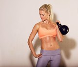 Female Athlete with a Kettlebell