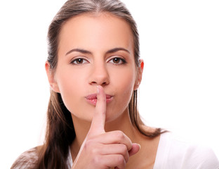 Portrait of beautiful brunette woman with finger on lips
