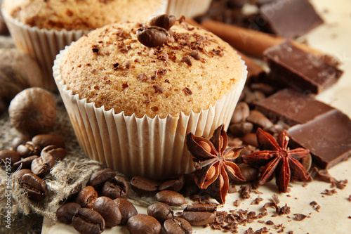 Poster tasty muffin cakes with chocolate, spices and coffee seeds,