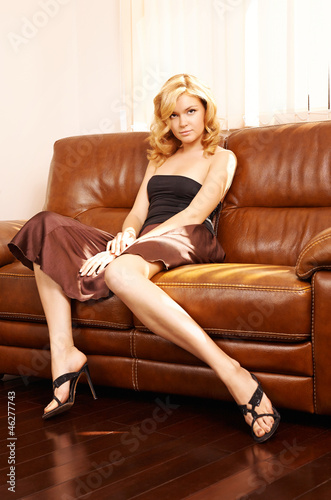 Young beautiful woman sitting on couch