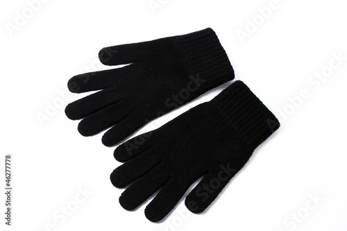 Black gloves on the white background