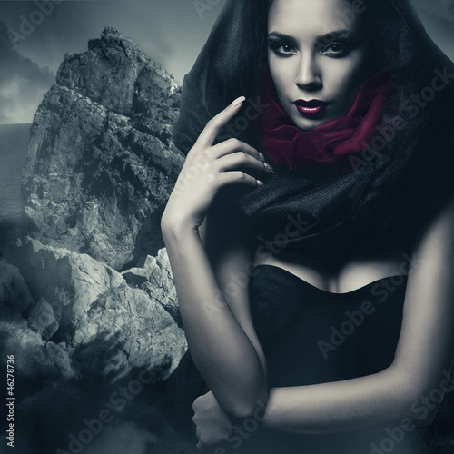 sexy woman in black hood and rock